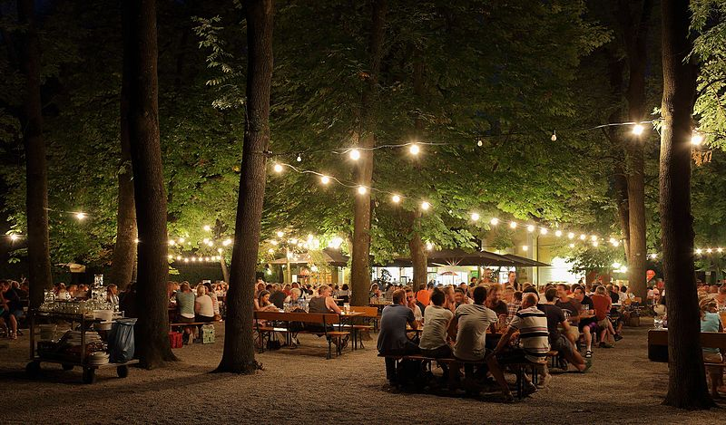 "Martin Falbisoner [CC BY-SA 3.0 (https://creativecommons.org/licenses/by-sa/3.0)], via Wikimedia Commons"" href=""https://commons.wikimedia.org/wiki/File:Biergarten_at_Night_2.JPG"""